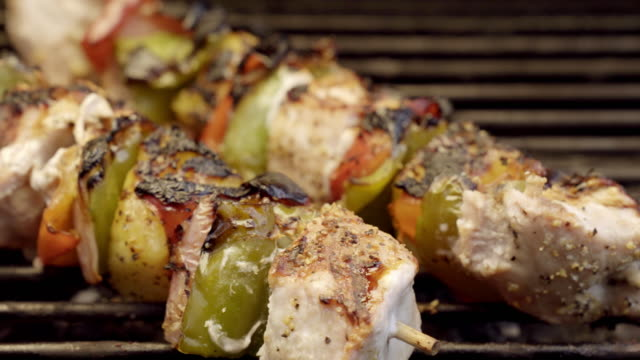 pork chicken shish kebabs on a fiery grill with peppers and pineapple - kebab stock videos and b-roll footage