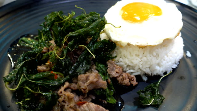 Pork fried and basil egg with rice.