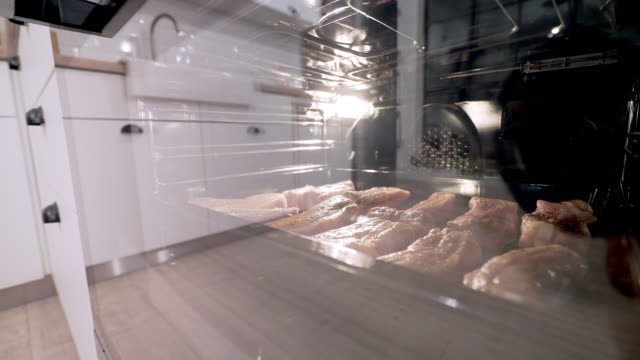 pork meat in the oven. - meat chop stock videos and b-roll footage
