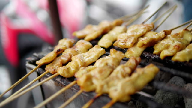 pork satay, street food, thailand. concept : street food , travel. - thai culture stock videos & royalty-free footage
