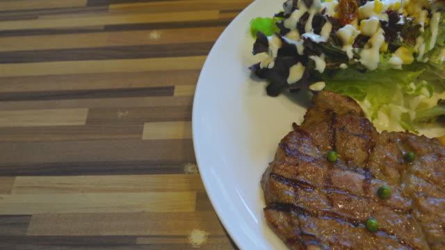 pork steak and salad hand truck shot - steak stock videos and b-roll footage