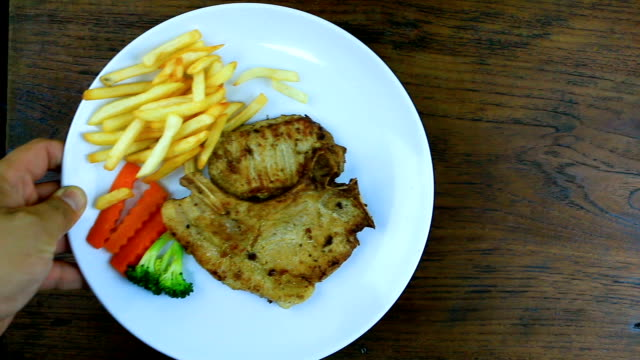 Pork Steak with French Fries and Bread, Bestseller in Thailand.