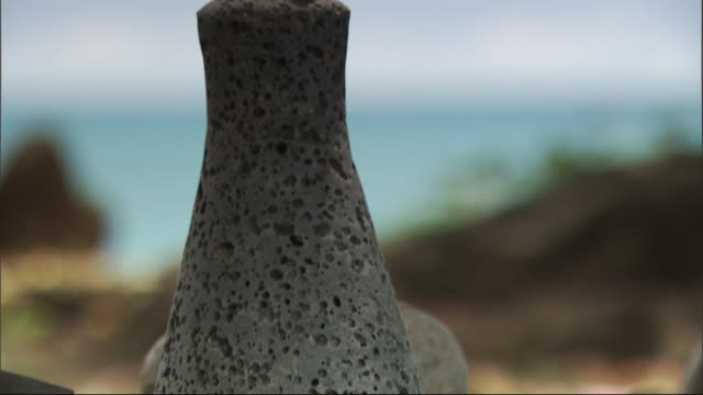 a porous stone sculpture is on the surface of a flat rock. - porous stock videos & royalty-free footage