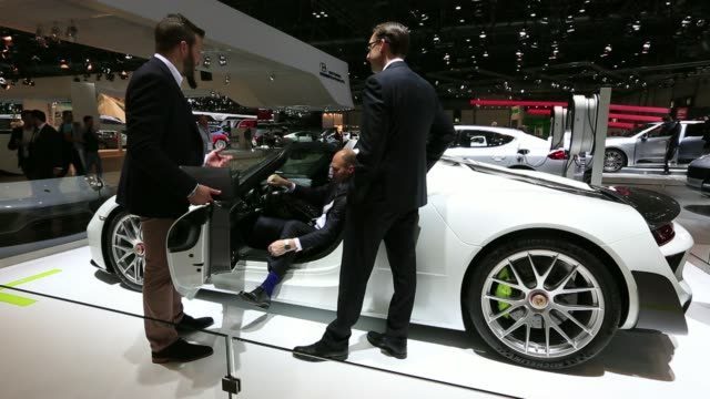 stockvideo's en b-roll-footage met a porsche boxster luxury automobile manufactured by porsche se sits on display at the auto mobil international automotive trade fair at leipziger... - hybride voertuig