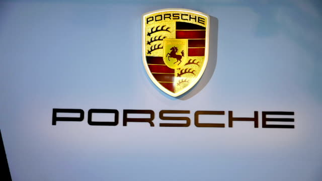 porsche display in the canadian international autoshow which is canada's largest automotive show held annually at the metro toronto convention centre. - verkaufsargument stock-videos und b-roll-filmmaterial
