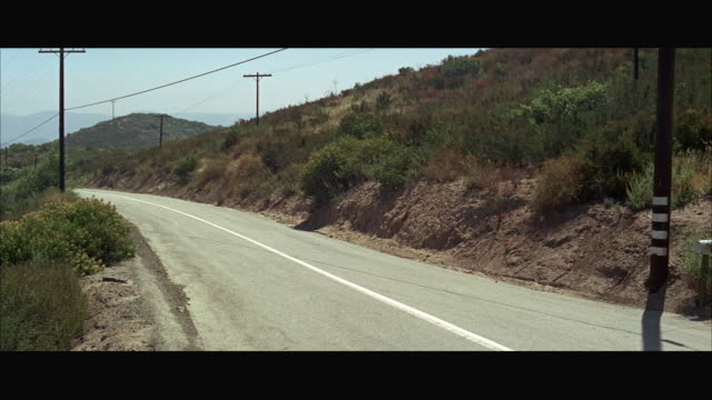 1966 WS PAN Porsche sports car riding down mountain road / California, USA