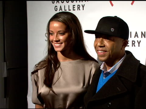 porschla coleman and russell simmons at the bono and damien hirst paint the town red for aids in africa - the auction at sotheby's in new york, new... - russell simmons stock videos & royalty-free footage