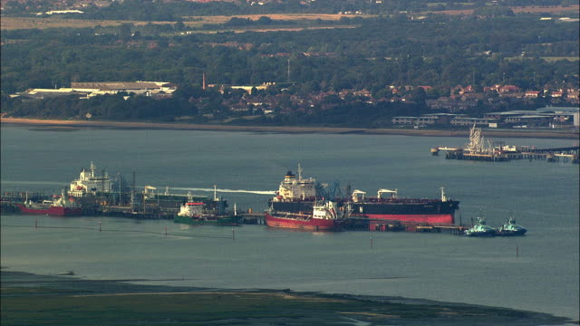 vidéos et rushes de low aerial port at cowes / isle of wight, united kingdom - cowes