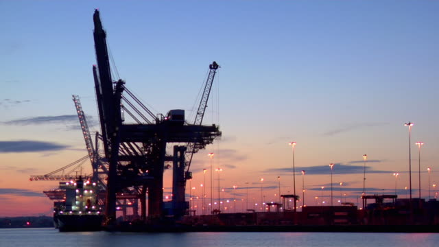 ws port at dusk, southampton, hampshire, united kingdom - southampton hampshire stock-videos und b-roll-filmmaterial