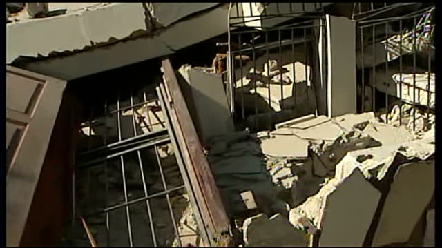 port au prince: ext edouard bazile showing reporter the wreckage of his home rubble of edouard's house edouard brazile interview sot - when got home... - torso stock videos & royalty-free footage