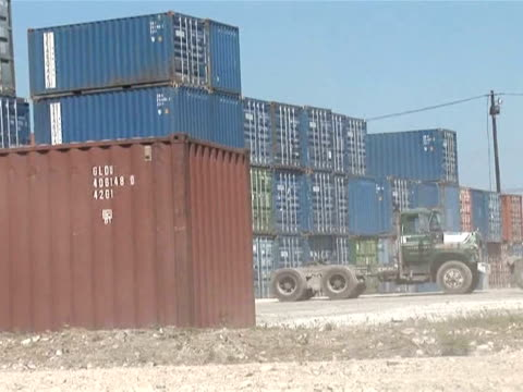 vídeos de stock e filmes b-roll de port authorities are working hard to repair maritime installations in haiti's ruined capital. the port was severely damaged during last week's... - hispaniola