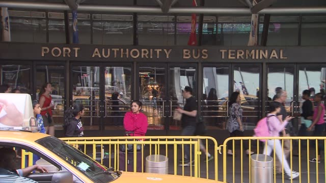 port authority bus terminal woman waits in front of bus terminal on august 03 2013 in new york new york - port authority stock videos & royalty-free footage