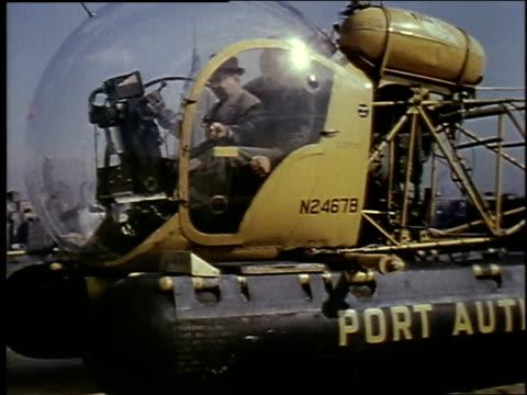 vídeos de stock e filmes b-roll de 1957 la port authority helicopter taking off / new york city, new york, united states - 1957