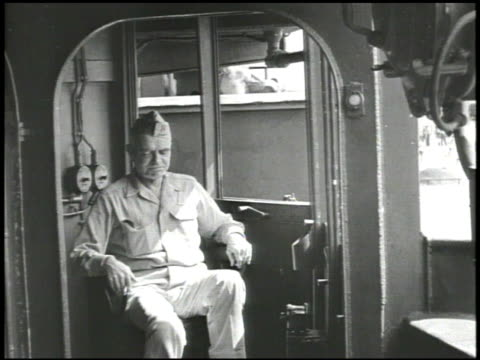 port bow of warship in rough seas vs us navy admiral william halsey jr walking to telescope looking in holding cigarette behind admiral halsey using... - william halsey stock-videos und b-roll-filmmaterial