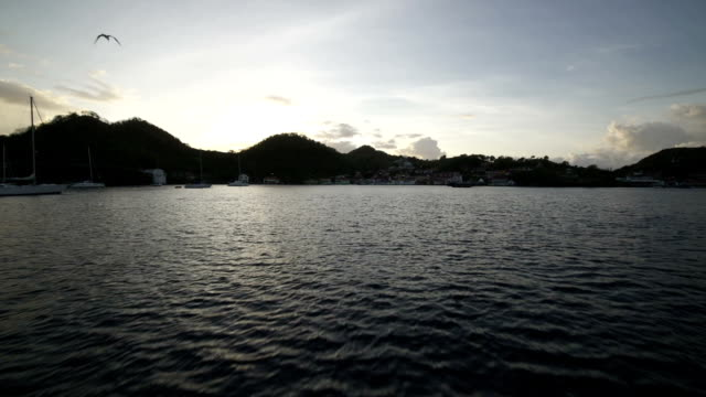 vidéos et rushes de port in the morning from moving ship - guadeloupe