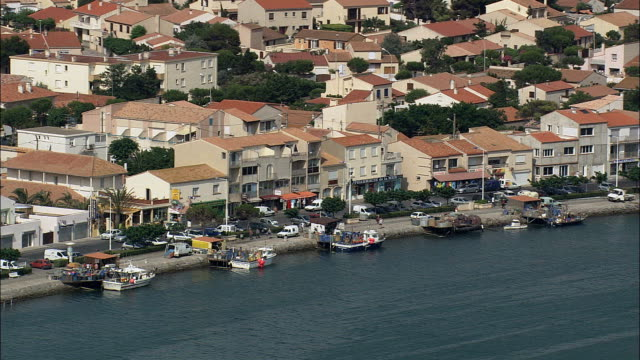 port la nouvelle - aerial view - languedoc-roussillon,  aude,  arrondissement de narbonne helicopter filming,  aerial video,  cineflex,  establishing shot,  france - aude stock videos & royalty-free footage