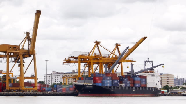 Port of container cargo ship time lapse and zoom out