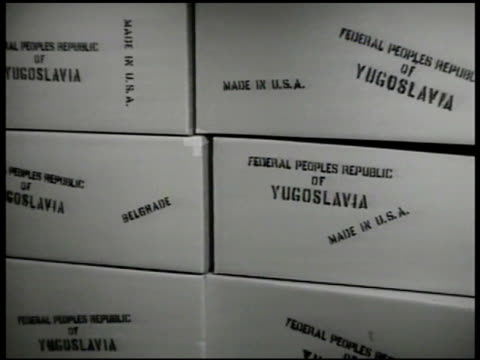 port of fiume. ship 'makedonija' in dock. boxes '..yugoslavia.' ext people walking on stairs. int yugoslavian family having dinner. vs elderly couple... - croazia video stock e b–roll