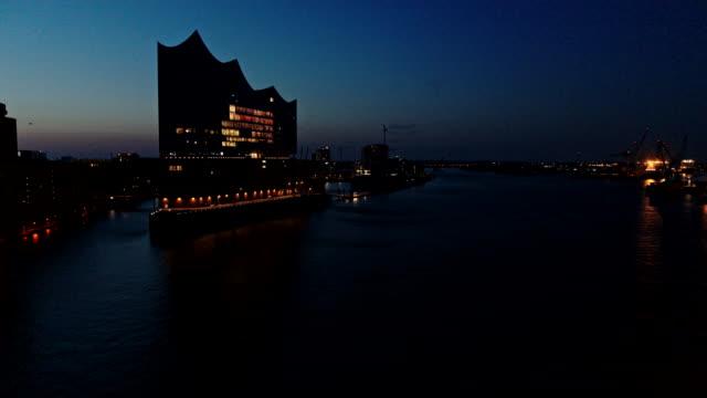 stockvideo's en b-roll-footage met port of hamburg, elbe philharmonic hall on elbe river, hamburg, germany - germany