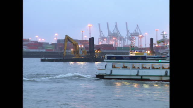 ws port of hamburg with digger and passing boat; 1998 - 1998 stock videos & royalty-free footage