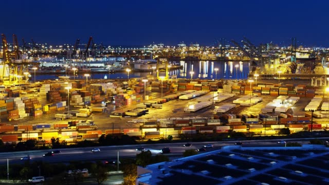 port of la lit up at night - molo video stock e b–roll