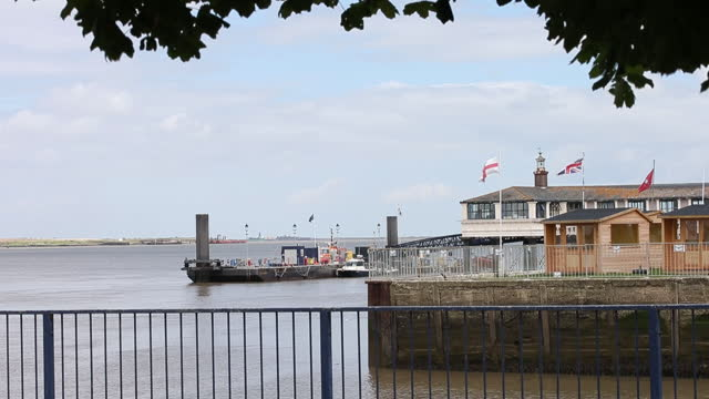 port of london waterfront, ferries and building exteriors in kent and essex, england, uk, on wednesday, july 7, 2021. - riverbank stock videos & royalty-free footage