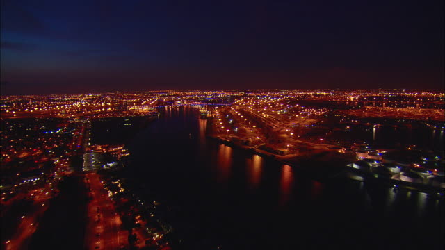 aerial port of long beach container facility illuminated at night, long beach, california, usa - long beach california video stock e b–roll