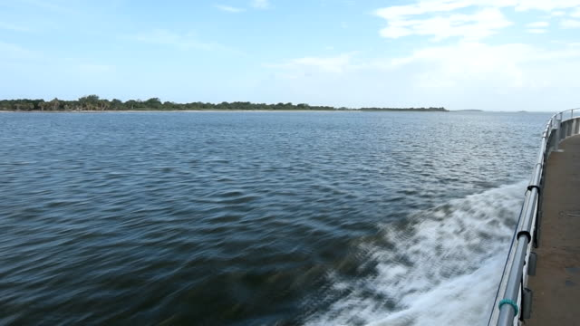 port side view from ferry, with water splashing and island at left - ferry stock videos & royalty-free footage