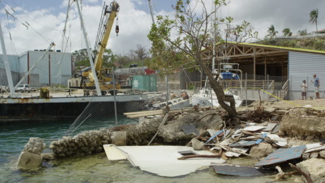 vanuatu - march 28, 2015: port, sunk boat, flotsam washed up. - rubble stock videos & royalty-free footage