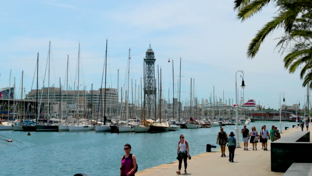 port vell harbour and cable car, barcelona, spain - overhead cable car stock videos & royalty-free footage