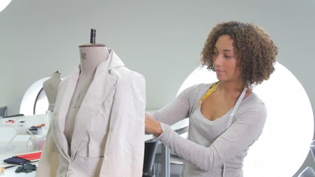 Portait of Female Fashion Designer working in studio