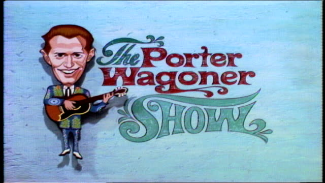 "porter wagoner and the wagonmasters open show, perform ""howdy neighbor howdy"" with speck rhodes on upright bass and dolly parton in bg. title card... - television show stock-videos und b-roll-filmmaterial"
