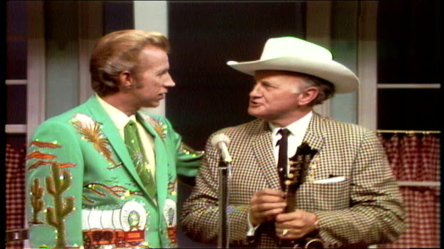 vídeos de stock e filmes b-roll de porter wagoner joins bill monroe on set. they discuss porter being a longtime fan of monroe and monroe's shows in missouri. - television show