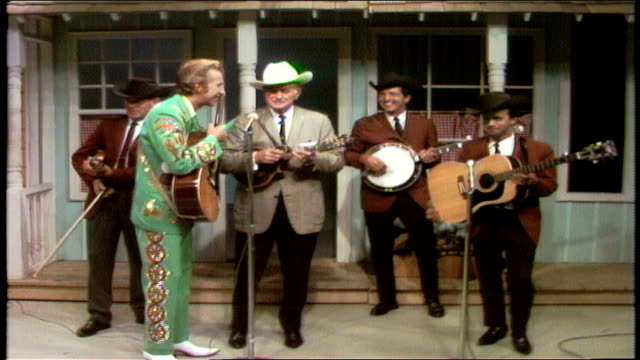 porter wagoner jokes about bill monroe being jealous of his tenor porter walks over to bill monroe and the bluegrass boys bill monroe introduces the... - bluegrass music stock videos and b-roll footage