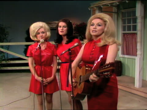 porter wagoner wearing black rhinestone-studded nudie suit, introduces dolly parton and her sisters stella mae and cassie parton. dolly and her... - television show stock videos & royalty-free footage
