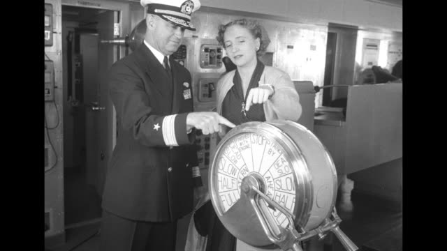 stockvideo's en b-roll-footage met vs porters sort and carry hundreds of packages gathered on promenade deck / cu baggage tag united states lines ss united states / vs captain harry... - margaret truman