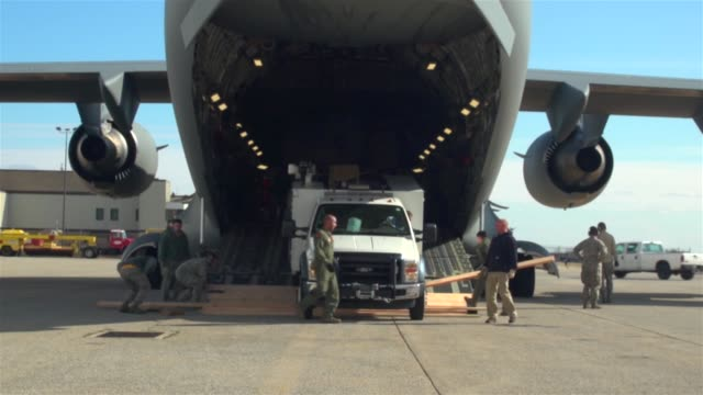 CRW Porters Support Hurricane Sandy Energy Task Force at JFK CRW airmen receiving and offloading powerservice vehicles at JFK International Airport...