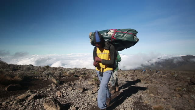3 porters w large climbing packs - tanzania stock videos & royalty-free footage