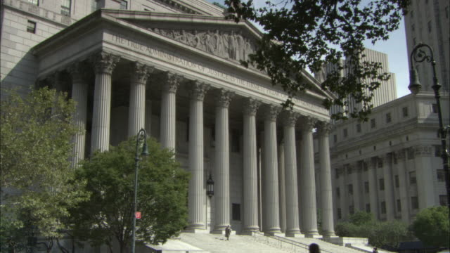 ws portico and classical columns of new york supreme court building / new york city, new york, usa - federal building stock videos & royalty-free footage