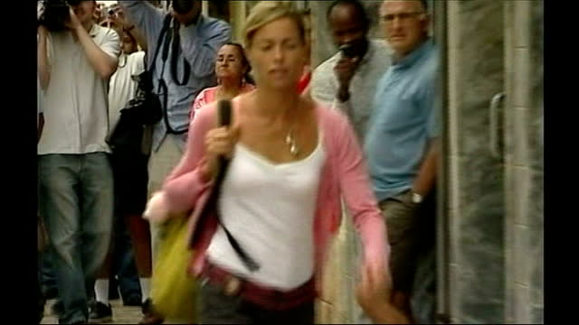 portimao: ext kate mccann arriving at police station for questioning over the disappearance of her daughter sot gerry mccann out of car as along to... - kate mccann stock-videos und b-roll-filmmaterial