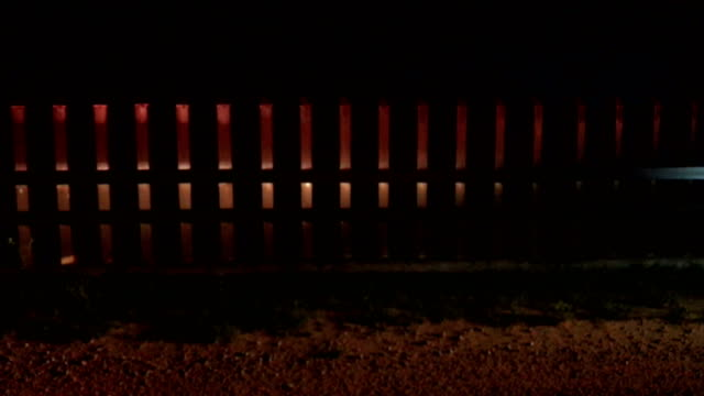 A portion of border fence is lit up by emergency lights on a US Border Patrol vehicle on February 22 2018 near McAllen Texas Border fencing is...