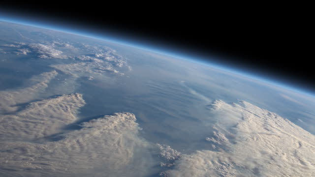 A portion of Earth's surface obscured by clouds as if viewed from space