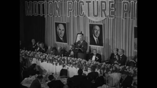 portion of harry warner's speech at the motion picture pioneers dinner honoring him and his two brothers includes ws with brothers jack and albert... - plakette stock-videos und b-roll-filmmaterial