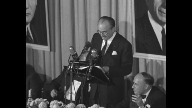 portion of speech given by jack l warner at dinner honoring him and his brothers / wider shot shows adolph zukor seated at head table on dais smoking... - warner bros stock videos & royalty-free footage