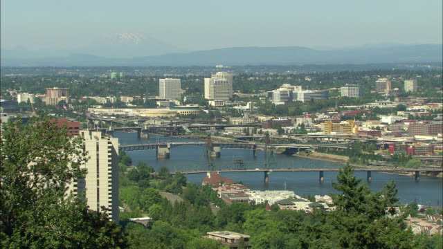 WS HA Portland cityscape with bridges cross on Willamette River and Mount St. Helens in distance / Oregon, USA