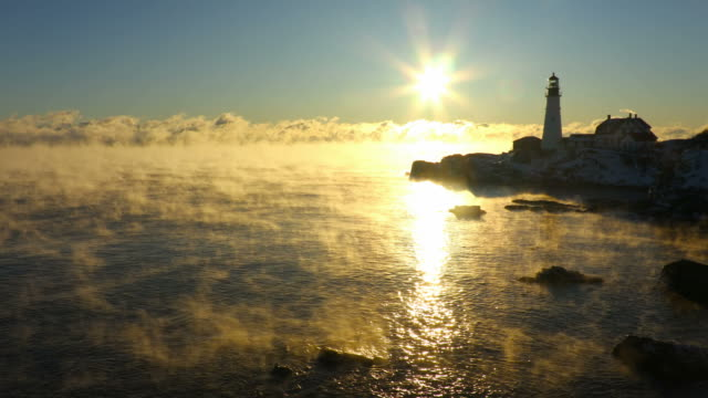 portland head lighthouse in arctic sea smoke - condensation stock videos & royalty-free footage
