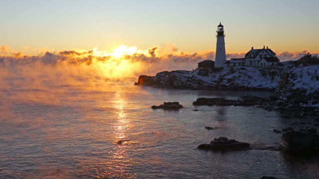 portland head lighthouse in arctic sea smoke - maine stock videos & royalty-free footage