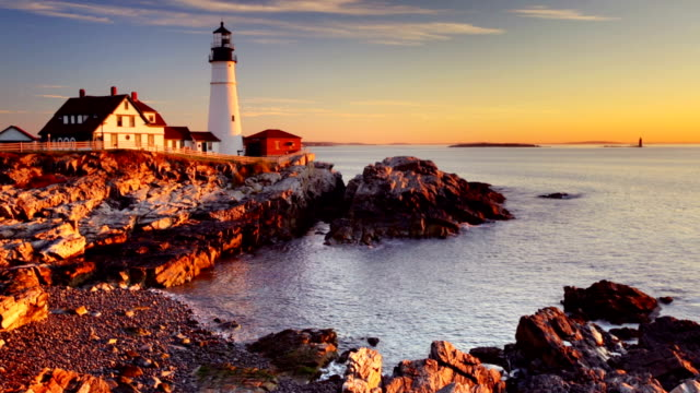 portland head lighthouse, maine, usa at sunrise - coastline stock videos & royalty-free footage