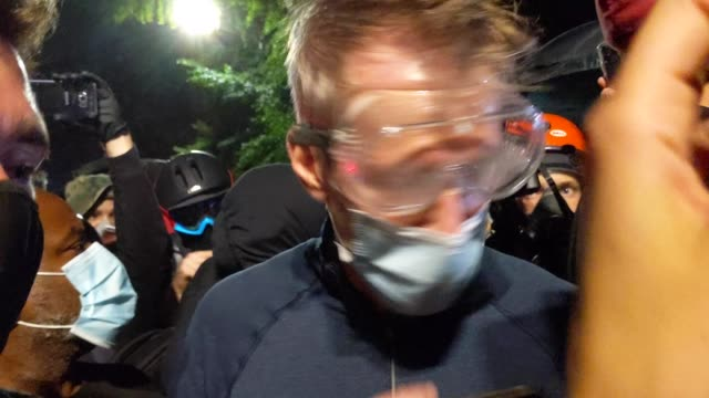 portland mayor ted wheeler reacts after being exposed to tear gas fired by federal officers while attending a protest against police brutality and... - oregon us state stock videos & royalty-free footage
