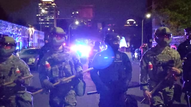 portland police and oregon national guard dispersed a protests on november 4, 2020 in portland, oregon. multiple protests, some peaceful and others... - portland oregon stock videos & royalty-free footage